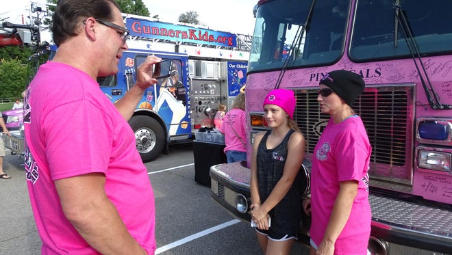 Melanie Wheeler, 13, center, of Galion, and mother Marci Wheeler tell Dave Graybill, founder of Pink Heals, about Melanie's battle with cancer during a video interview Wednesday in Galion.