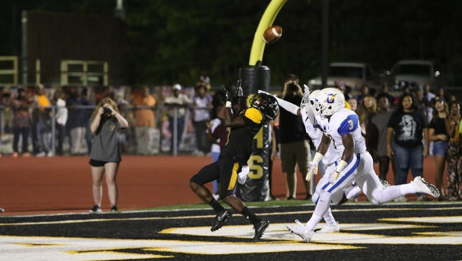 Starkville wide receiver Rufus Harvey makes a second-quarter touchdown catch over Oxford's Jauanzi Johnson and CJ Terrell.