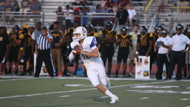 Oxford quarterback John Reece McClure and the Chargers went to Horn Lake on Friday and beat a previously-undefeated team 21-0.