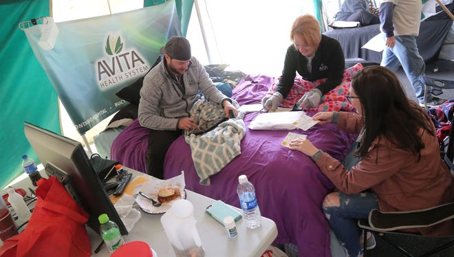 Sean Weaver, Lesa Gifford and Tierney Johnson, all from Avita Health in Ontario, compete in the Great Sleep-Out Against Domestic Violence at Johnny's Mattress & Furinature Superstore on Friday afternoon. The event helps raise money for the Domestic Violence Shelter.
