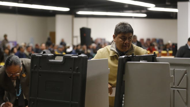 Navajo Nation Council Delegate Jonathan Hale casts his ballot to name a speaker for the tribal council on Jan. 23 in Window Rock, Ariz.
