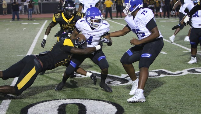Starkville defense led by Zach Edwards tackles Jaquaris Dean of Meridian.