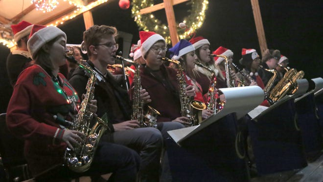 The Ontario High School Jazz band plays holiday melodies during the Ontario Christmas Tree lighting on Thursday night.