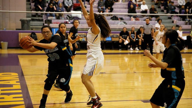Navajo Prep's Kariah Wilson keeps the ball in bounds during the first quarter of Friday's game at Kirtland Central. For the latest video highlights, photo galleries and scores, visit daily-times.com.
