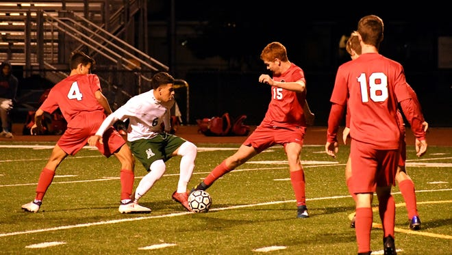 Junior Angel Amezcua tries to get past Burlingame's defense in the first half. Despite many good shot attempts for Alisal in the first 40 minutes, the game went to halftime in a 0-0 tie.