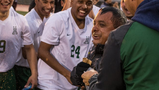 Alisal Trojans head coach Mark Cisneros was showered in Gatorade by seniors Jesus Ochoa and Miguel Lazcano after the 3-1 win over Richmond.