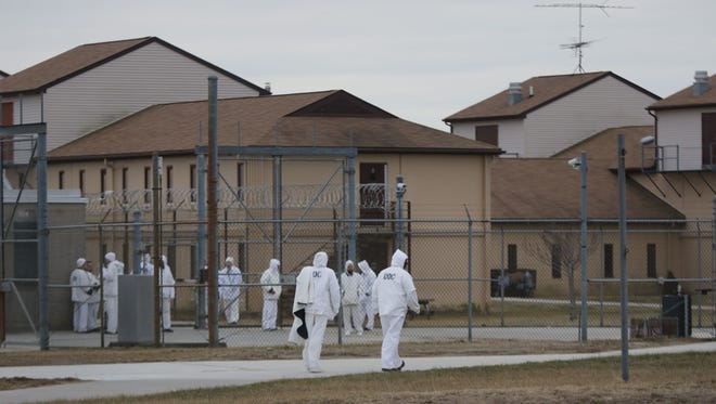 Inmates walk between buildings at James T. Vaughn Correctional Center.