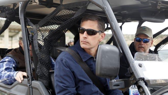 U.S. Sen. Martin Heinrich, D-N.M., rides in an off-highway vehicle Wednesday in the Glade Run Recreation Area.