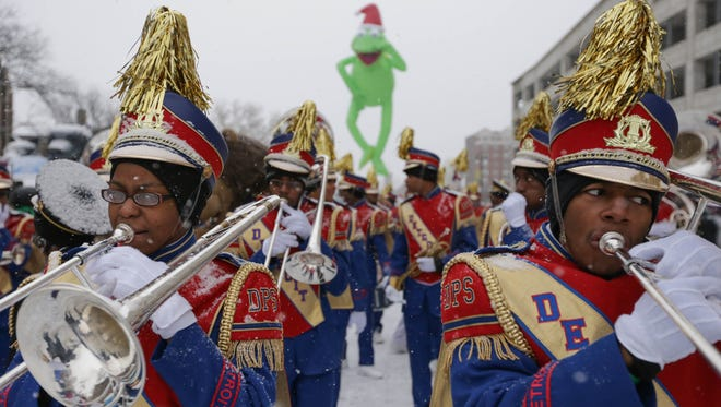 Detroit All-City High School marching band members warm up before the start of the 2013 America's Thanksgiving Parade makes it's way down Woodward Avenue in downtown Detroit on Thursday November 28, 2013.