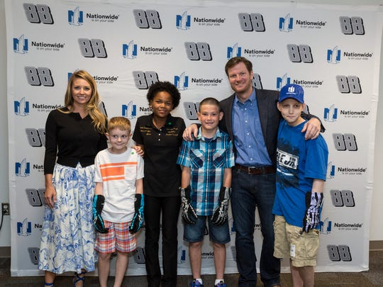 Dale Earnhardt Jr. and fiancé Amy Reimann pose with this year's four Nationwide Children's Hospital Patient Champions: (left to right) Aiden VanWagner, Tarissa Suchecki, Dalton Miller and Grant Reed.