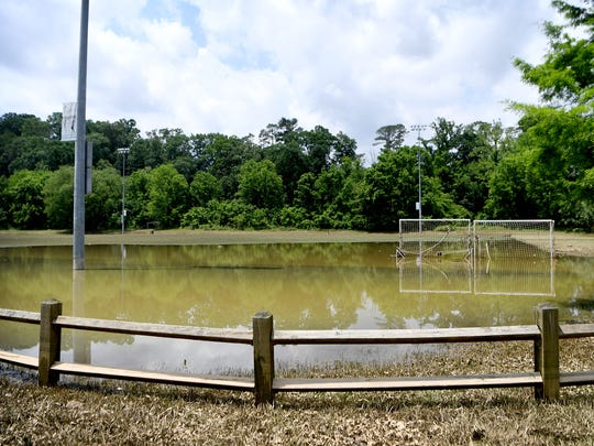 Although much of the flood water had receded a considerable pool was still left on one of the fields at the City of Asheville's John B. Lewis Soccer Fields on Thursday, May 31, 2018.