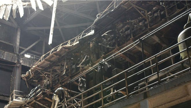 This file photo shows the extent of damage from an explosion and resulting fire at Cabras 3 and Cabras 4 power plants.