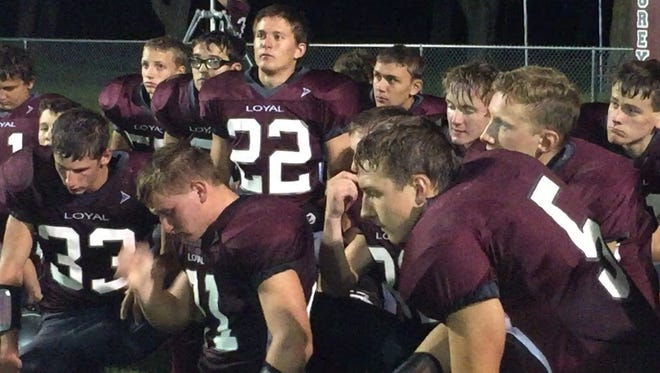 Loyal players listen to Greyhounds coach Chris Lindner following the team's loss to Bangor on Friday