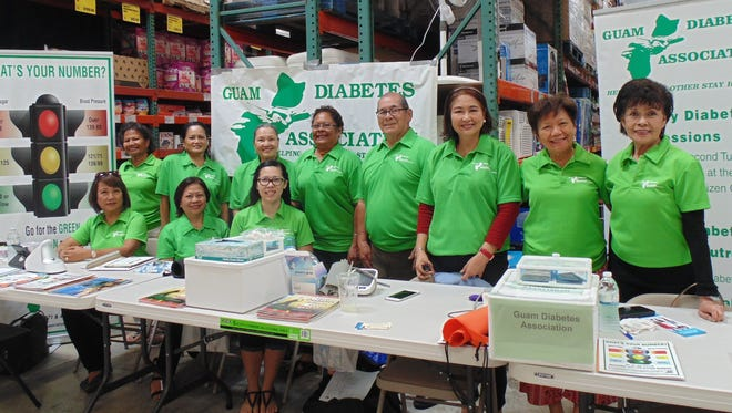 The Guam Diabetes Association hosted a Community Outreach at the Cost-U-Less Supermarket in Tamuning on March 25.  The volunteers conducted GLucose Screening. Blood Pressure Testing, Anti-Oxidant Analysis and Counseling. Diabetes Brochures were distributed to everyone.  Cost-U-Less provided assorted diced fruits to the participants. Pictured from left: GDA Volunteers. Seated: Linda Simon, Nilda Antolin RN, Joame Topacio PT. Standing: Lisa Kenworthy, Eva Allen RN, Carrie Duenas, Rosa Giramur, Scott Duenas, Del Agahan, Dr. Yolanda Carrera MD, and Winnie Butler.