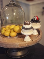 Find a unique cake stand and add several kitchen accessories.