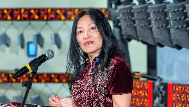 Mei Han, director of the Center for Chinese Music and Culture, speaks at the dedication ceremony for the Middle Tennessee State University facility.