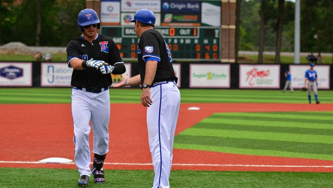Louisiana Tech coach Greg Goff, right, talks with Marshall Boggs during a game earlier this month. The Bulldogs host Rice for a three-game series this weekend.
