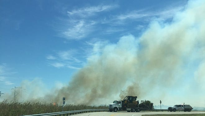 Firefighters respond to a brush fire in western Brevard County off of County Road 520.
