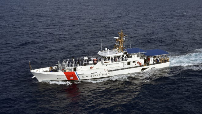 The Coast Guard Cutter Lawrence Lawson crew mans the rail during sea trials off the coast of Miami, Florida, on Dec. 12, 2016. Two ships similar to this will be stationed in Astoria, Oregon.