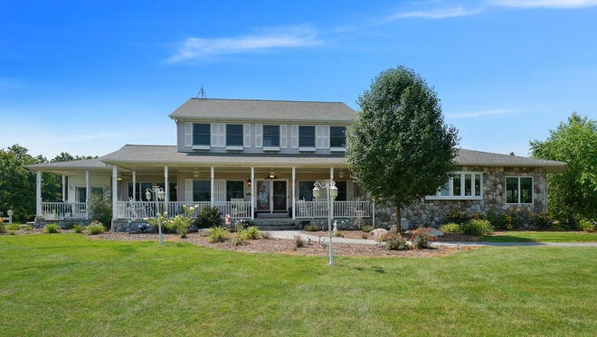 The large Colonial-style home sits on 30 secluded acres in Cottrellville Township.
