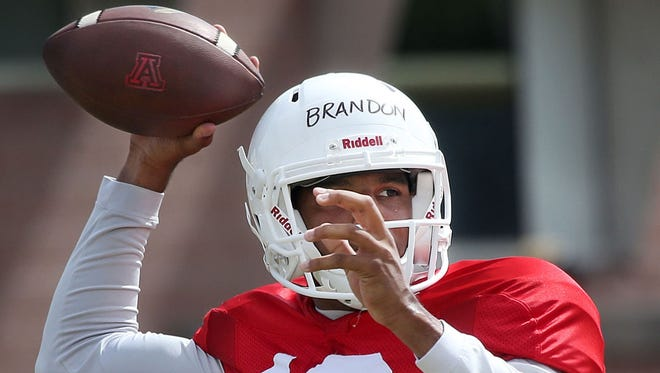 Arizona quarterback Brandon Dawkins wasn't spectacular in the Wildcats' scrimmage on Saturday, but likely solidified his role as UA's starting quarterback.