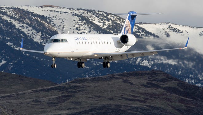 This file photo from 2016 shows a SkyWest-operated Bombardier CRJ-200 lands at Reno-Tahoe Airport under the United Express brand.