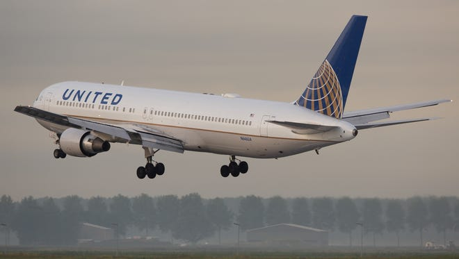 A United Airlines Boeing 767-300 lands at Amsterdam Schiphol Airport in August of 2016.