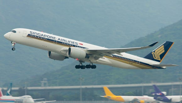 A Singapore Airlines Airbus A350-900 takes off from