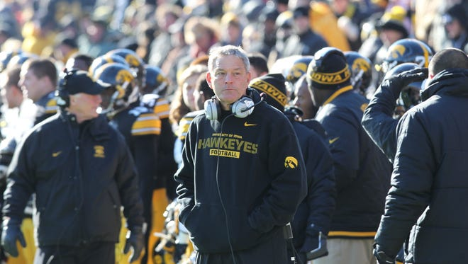 """Kirk Ferentz is shown on the sidelines during the 2013 """"Blackout"""" game against Michigan."""