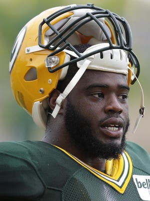 Packers defensive tackle Christian Ringo takes a break.