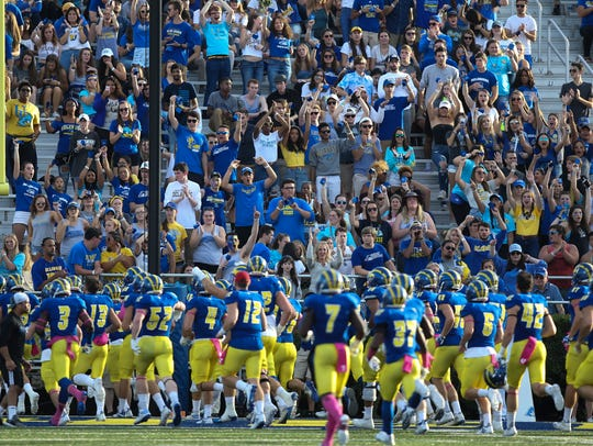 The Hens are saluted by the student section as they leave the field up 21-14 at halftime vs. Richmond last year at Delaware Stadium.