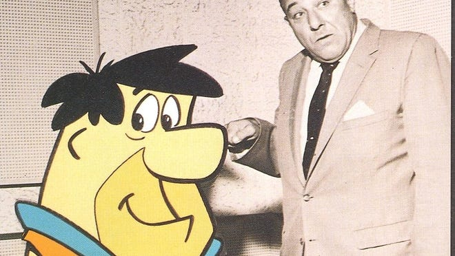 Alan Reed, who voiced the cartoon character Fred Flintstone.