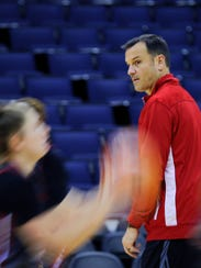 Louisville coach Jeff Walz runs a play during practice