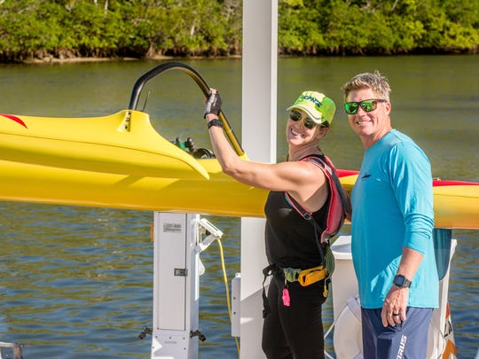 Ana Garcia is pictured with Adam Whittington, owner of Blueline Surf and Paddle.
