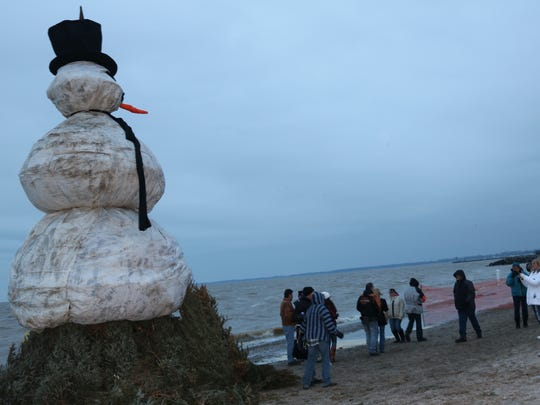 "People stop to take photos with ""Floyd,"" the 30-foot centerpiece of the fourth annual Burning Snowman Festival in 2018."