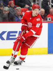 Detroit Red Wings defenseman Danny DeKeyser (65) skates