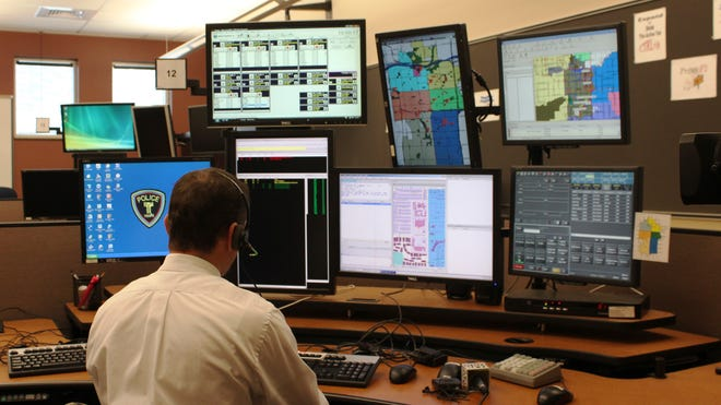 """""""They (Tempe police dispatchers) work in a world that is error intolerant,"""" says Del Webb, the center's communications supervisor."""