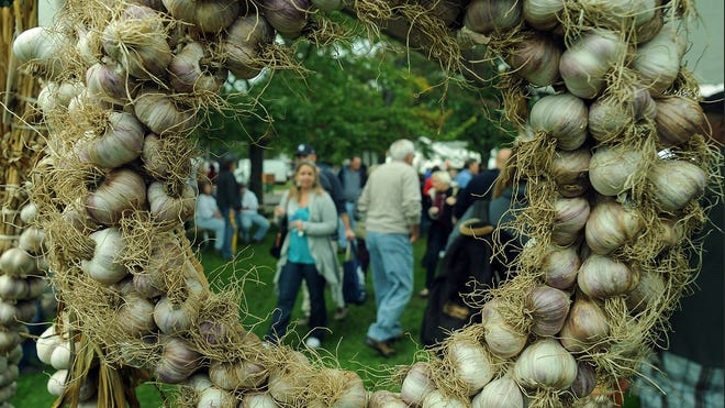 People attend the Garlic Festival in Saugerties in 2012. This year's festival will continue today from 10 a.m. to 5 p.m. at Cantine Field.