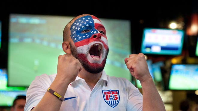Julio Loaiza of Visalia watches the U.S. soccer team with other fans at Buffalo Wild Wings in Visalia on Tuesday, July 1, 2014. The U.S. was eliminated by Belgium 2-1 in overtime.