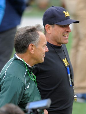 Michigan State coach Mark Dantonio and Michigan coach Jim Harbaugh are both on the Bear Bryant Coach of the Year Watch List.