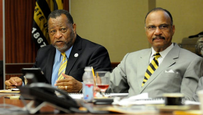 Elton Dean (left) and John Knight attend a meeting of the Alabama State Board of Trustees on Friday, April 25, 2014.