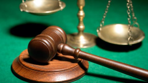 A Gloucester Township middle school aide is accused of sexual acts with a former student.