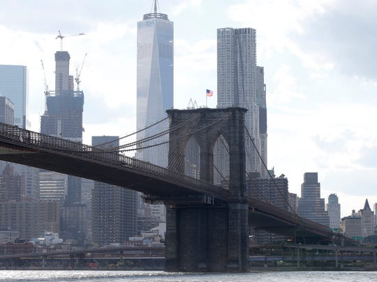 In this June 30, 2016 file photo, the Brooklyn Bridge spans the East River from Brooklyn into Manhattan, as seen from Brooklyn Bridge Park, in New York.