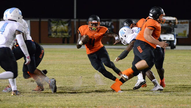 Cocoa Tiger Bruce Judson carries the ball for big yardage Friday night as the Tigers hosted Rockledge.