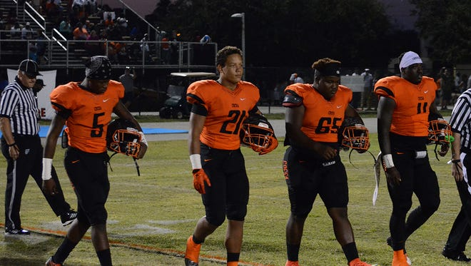Cocoa Tigers team captains approach midfield for the coin toss Friday night. Jekevius Henry, Zach Beagle, Naceiya Gilmore, and Bruce Judson.