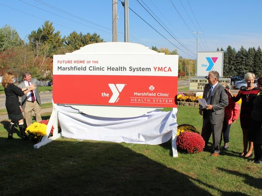Representatives of Marshfield Area YMCA and Marshfield Clinic Health System unveil new sign for Marshfield Clinic Health System YMCA Tuesday, Oct. 11, 2016.