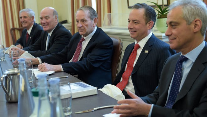President-elect Donald Trump's incoming White House Chief of Staff Reince Priebus, second from right, attends a meeting with former White House Chiefs of Staff in the office of current White House Chief of Staff Denis McDonough at the White House in Washington, Friday, Dec. 16, 2016. From left are, Andrew Card, Bill Daley, Samuel Skinner, Priebus and Rahm Emanuel.