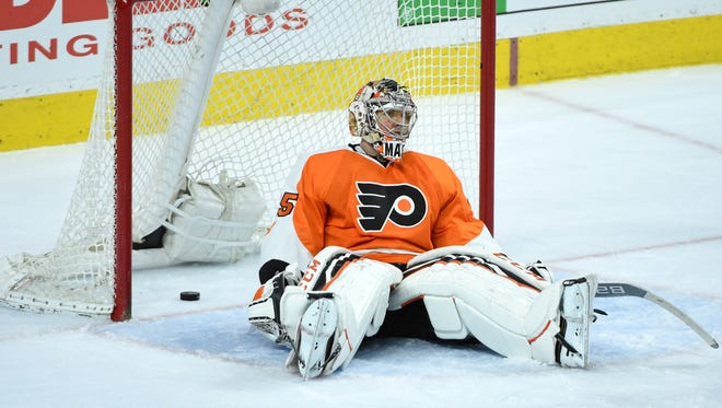 Philadelphia Flyers goalie Steve Mason (35) reacts after allowing the game winning goal during the overtime period against the Toronto Maple Leafs at Wells Fargo Center.
