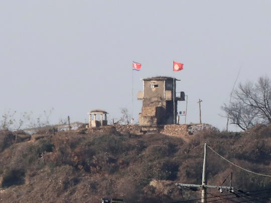 North Korean military guard outpost with its flag, left, is seen from Paju, South Korea, Tuesday, Nov. 14, 2017.