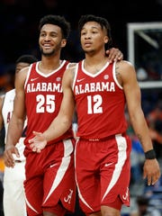 Alabama's Braxton Key (25) and Dazon Ingram (12) celebrate beating Auburn, 81-63, in the SEC Tournament Friday, March 9, 2018, in St. Louis.